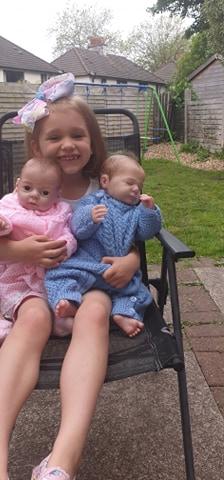 children sitting in chair