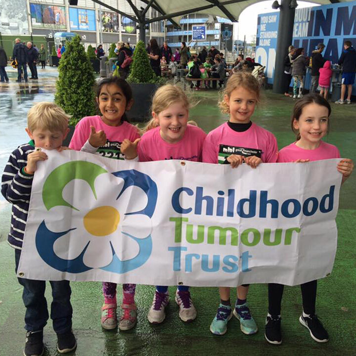 Children stood with childrens tumor trust banner